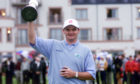Scotland's Paul Lawrie holds the Claret Jug aloft after winning the 1999 Open Championship at Carnoustie, following a play-off with Justin Leonard and Jean Van De Velde.