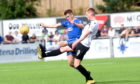 Jamie Redman, left, in action for Cove.