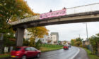The banner was attached to a footbridge over the A96 Aberdeen to Inverness road in Elgin. Picture by Jason Hedges.