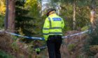 An officer at the scene in Birkenhill Woods
