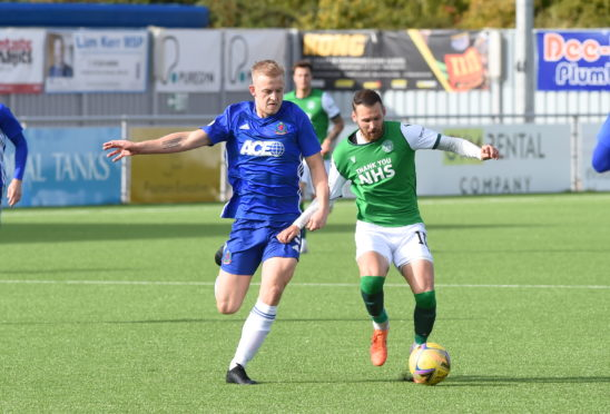 Harry Milne goes up against Martin Boyle during Cove Rangers' Betfred Cup tie with Hibernian.