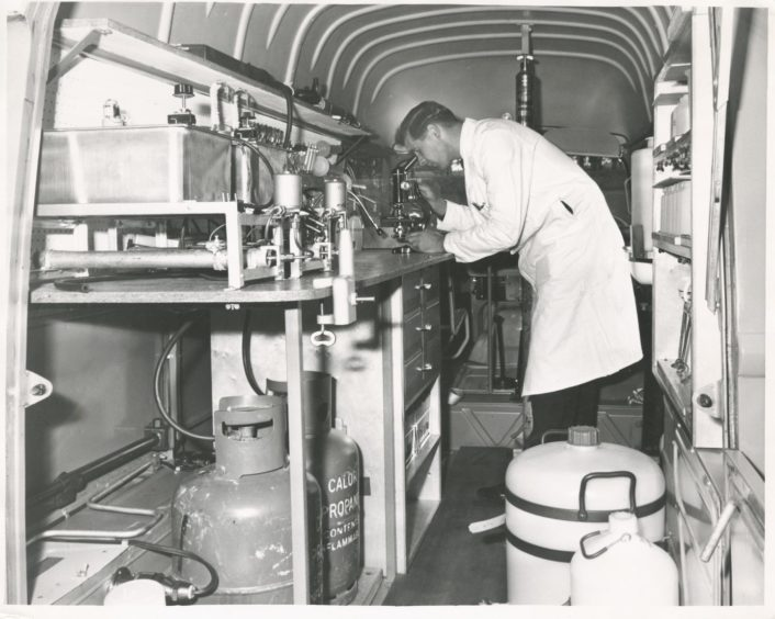 1966: A lab technician at work in the Rowett Institute's mobile laboratory.