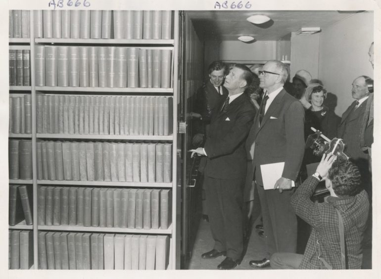 1967: Opening of the Charles Alexander Wing of the Reid Library at the Rowett Research Institute yesterday. Mr William Ross the Secretary of the State for Scotland and Mr Charles Alexander examine the library with mobile shelves to facilitate storage.