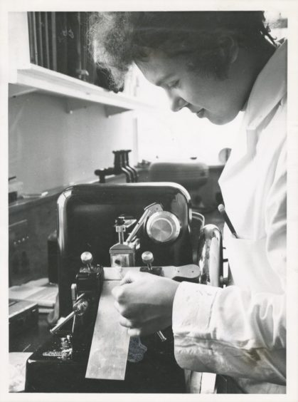 1970: Miss S. Moon cutting sections of tissue for microscopic examination in the experimental pathology department at the Rowett Institute.