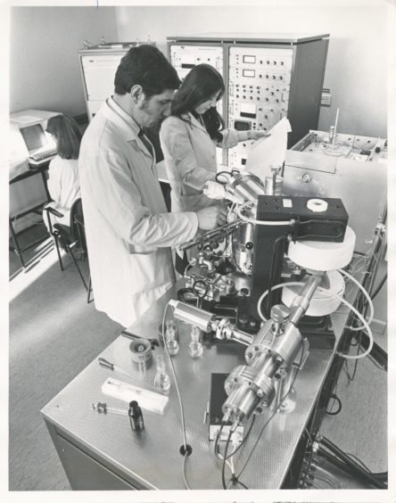1979: One of the Rowett Institute's latest, and most expensive pieces of equipment is a mass spectrometer - for the analysis of organic material. Using the spectrometer are Dr Alistair and June Walker.