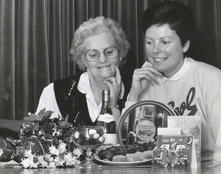 1988: You may look but you cannot touch if you want to stay slim this Christmas. Moray women Constance Milne (left) and Dorothea Taylor, who are taking part in the human nutrition experiments at the Rowett Research.