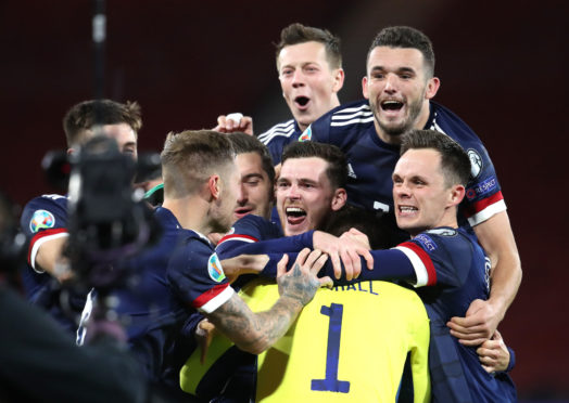Scotland's players celebrate victory in the penalty shoot-out.
