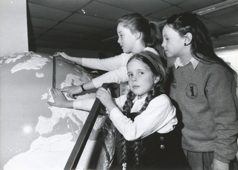 1990: Measuring the distance between Aberdeen and the North Pole are Towie pupils Becky Johnson, Joanne Dennerley and Melissa Grimley.