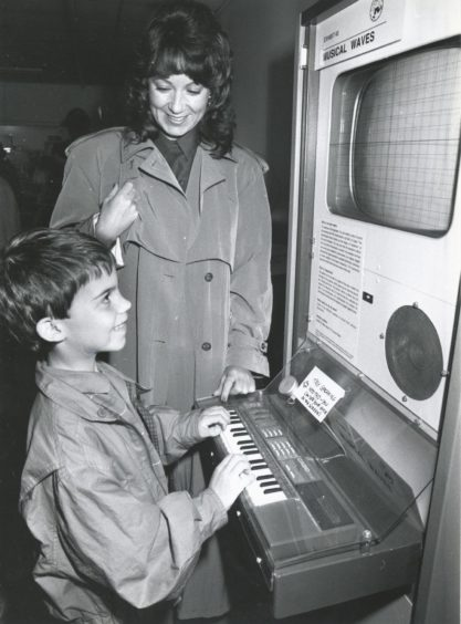 1990: Mrs Lesley Fyfe and her son, James (7), from Drumoak, enjoy the Musical Waves machine at Aberdeen's Satrosphere.