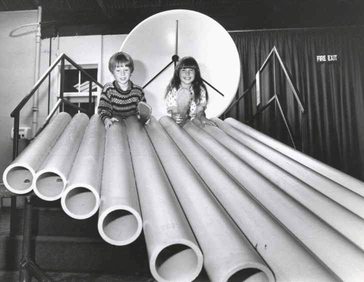 1990: Five year old David Rennie and his sister, Yvonne (7), Drumossie Avenue, Inverness, play a tune on Satrosphere's pan pipes.