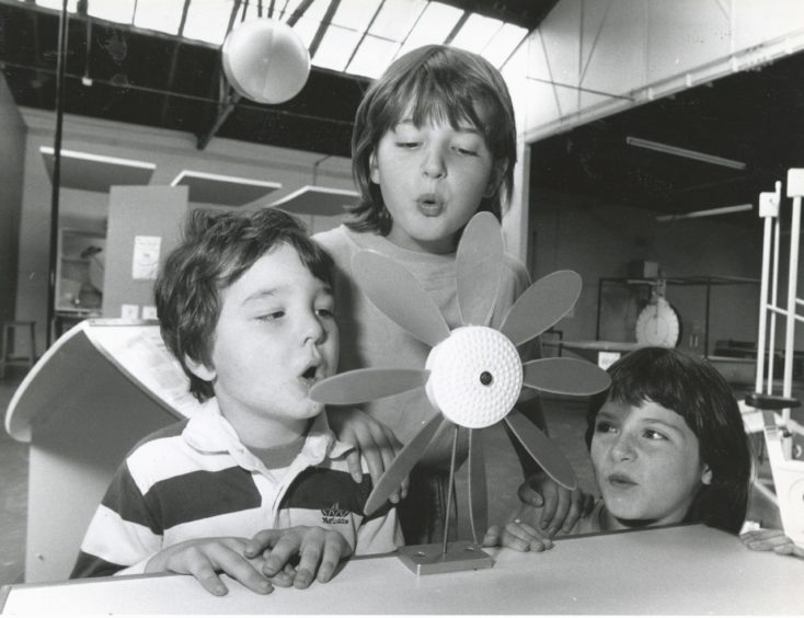 1990: Blowing up a small storm at the wind table at Satrosphere are (from left) Douglas Elder (4), Laura Taylor (9) and Fiona Elder (9), all of Strachan.