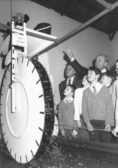 1991: Electric experience: Hydro Electric Board chairman Michael Joughin (back right) shows Newtonhill Primary School pupils the principles of making electricity from water with the Satrosphere exhibit sponsored by the company. Satrosphere's chairman Mr Calum MacLeod looks on.