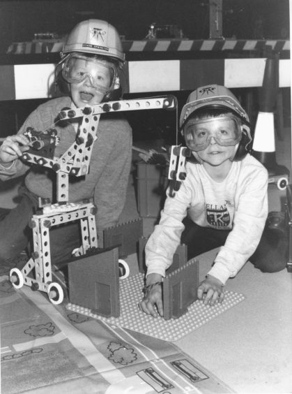 1991: Keith Wood (9), left and Keith McKessar (9), both Kellands Primary, Inverurie, try their skills on the model construction site at the Festival of Toys now on display at Satrosphere, Justice Mill Lane, Aberdeen. The festival scientific toys and construction kits and highlights the safety aspects of toys.