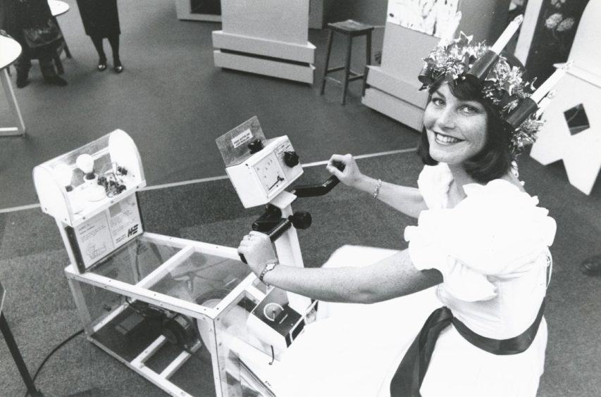 1993: Aberdeen's Queen of Light, Suzanne Wilson, generates electricity by pedalling an exercise cycle at the opening of an energy exhibition at Satrosphere, in Aberdeen yesterday.