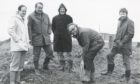 "Shell 1980-03-17 Altens Site (C)AJL  ""About to dig the first turf at Shell Expro's new site at Altens industrial estate, Aberdeen, is their general manager Mr Bill Murphy watched by (left to right) - Mr David Brewster, head of Shell Expro's property services; Mr Dall Fraser, administration manager; Mr Harry Nicolson of Fairhurst and Partners, clerk of works for the development and Mr Ken Cruickshank, engineer with Fairhurst and Partners.""  Used: P&J 18/03/1980"