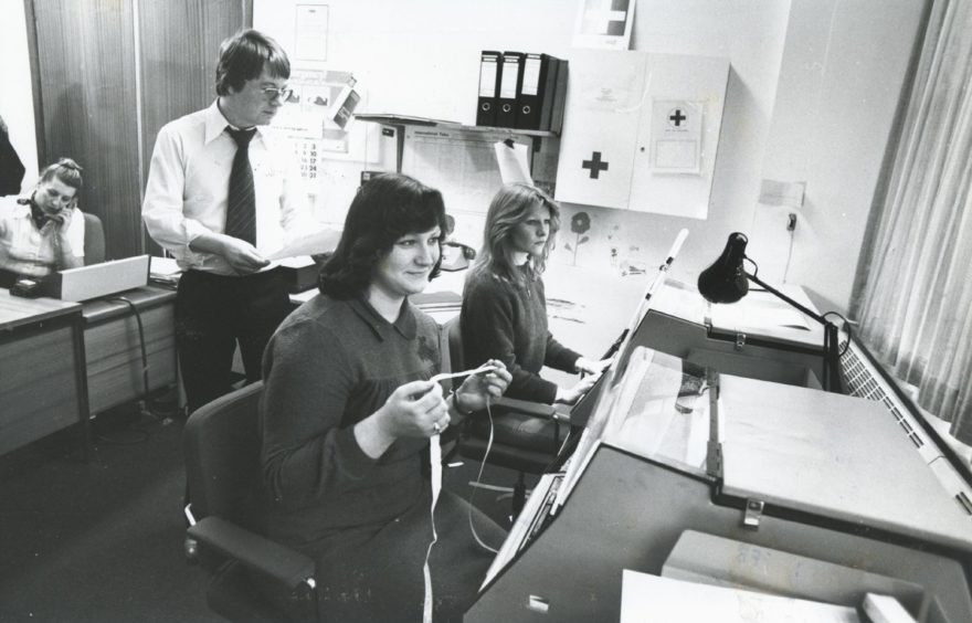 "Shell 1982-02-01 Linda Bremner (C)AJL  1 February 1982  ""No, that's not knitting Linda Bremner is holding...she, Lynne McCluskey (right) and Mark Holburn are busy in the Telex room at Shell Expro's Combie Road offices in Aberdeen.""  Used: P&J 17/02/1982"