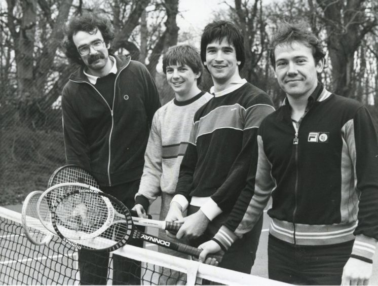 "Shell 1983-02-27 Tennis (C)AJL  27 February 1983  ""Ready for the start of their doubles tennis match are (left to right) Ian Newth and Mike Strachan of BP, and Hugh Mitchell and Alan Lamont from Shell.""  ""Competition between oil companies in the North east reached an all time high yesterday - but it was all good clean sporting fun. Thirty three teams representing 26 oil companies, competed for the Aberdeen Conference Centre Super Sports Star Trophy at the centre at Foveran House, Newburgh. About 350 men and women took part in the one day event which included an obstacle course race, tennis, pentanque, pool and darts.""  Used: P&J 28/02/1983"