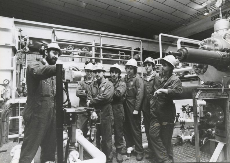 1986: Instructor Mr John McAllister of Fyvie demonstrates some machinery to a group of six students. From left: Jonathan Briggs, Westhill; Graham Wood, Portknockie; Brian Pirie, Fettercairn; Charles Christie, Lhanbryde; Robert Fraser, Westhill and Malcolm Stewart, Fyvie.