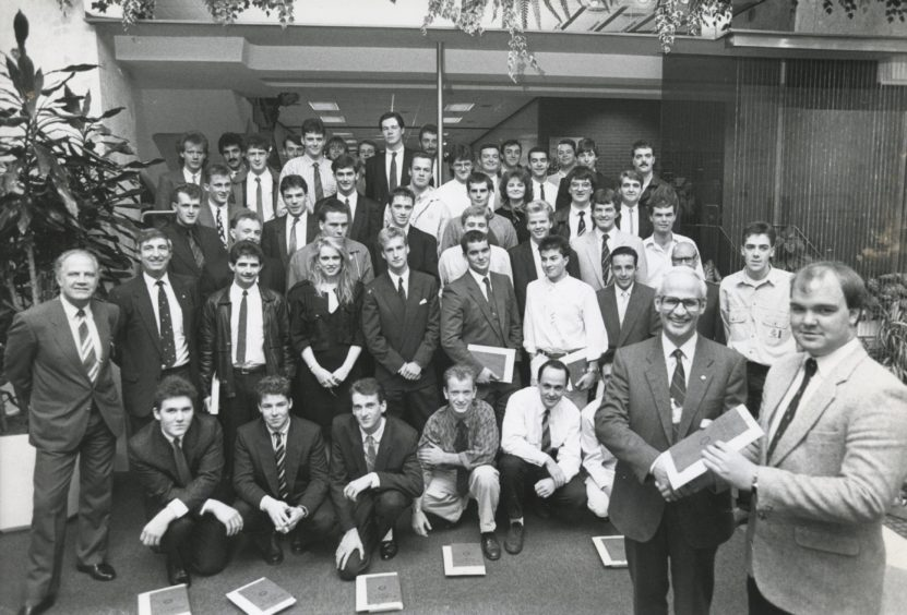 "Shell 1988-09-14 Graduation Ceremony (C)AJL  14 September 1988  ""Fifty successful students from throughout Scotland and as far south as Norfolk look on as Shell Expro director of operations Mr Ian Henderson presents Kevin Barrie, Macduff, with his Shell Expro Technician Scheme graduation certificate, at a ceremony in the Shell offices, Tullos, Aberdeen, yesterday.""  Used: P&J 15/09/1988"