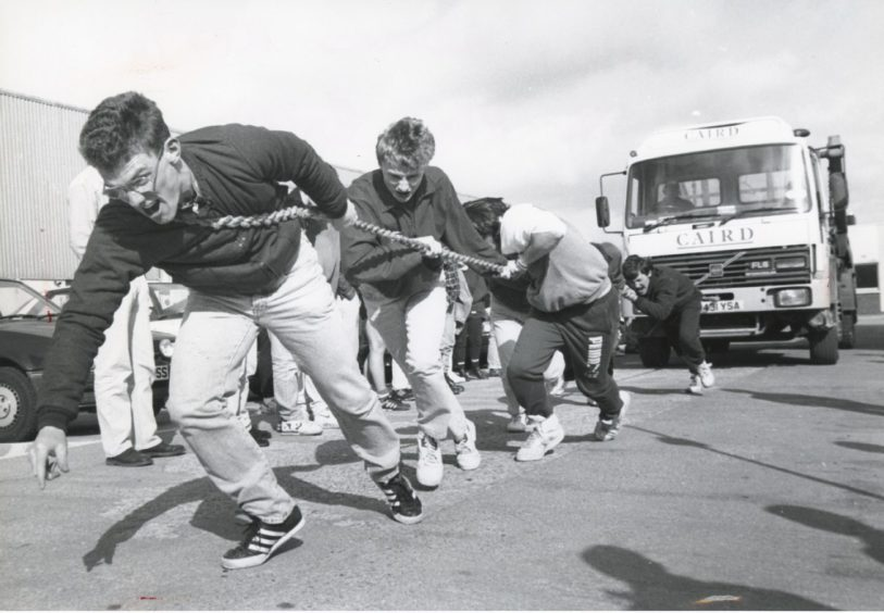 "Shell 1991-05-03 Alex Ritchie (C)AJL  3 May 1991  ""Anchorman Alex Ritchie gives his all in the tug-a-truck event to raise funds for the Special Olympics.""  Used: EE 06/05/1991"