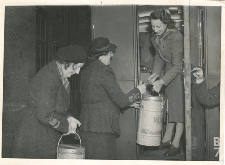1947: Helping out: The Women's Voluntary Service hard at work delivering meals in Aberdeen during the post-war era.