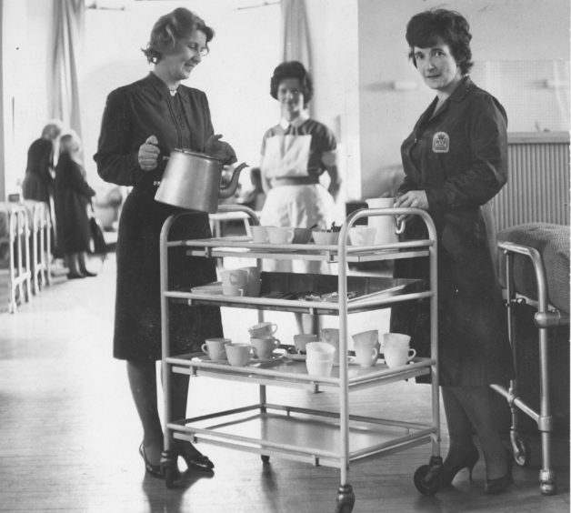 1966: Mrs Osborne (left of the trolley) handing out tea in one of the wards at Kingseat, and (below) helping at the tea stall.
