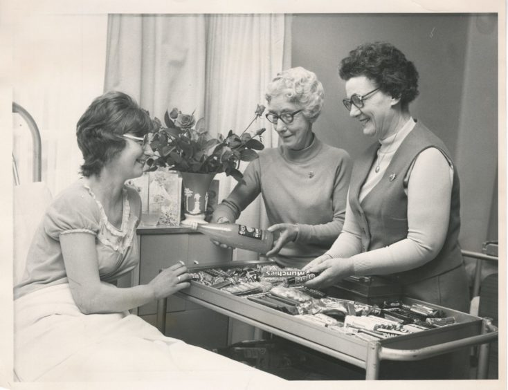 1977: WRVS members Miss Charlotte Grant and Mrs Jean Begg (right) provide a trolley service for patient Mrs Mary Bruce, Mains of Inkhorn, Auchnagatt, in Aberdeen Royal Infirmary maternity unit.