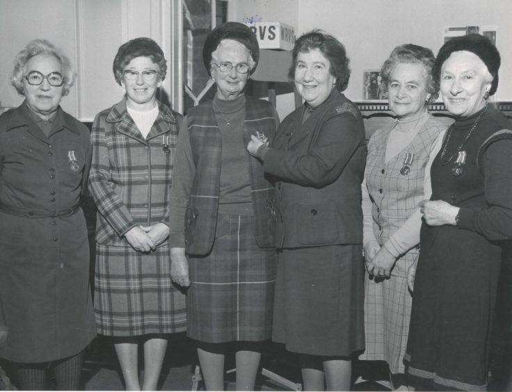 1979: Grampian Region organiser for WRVS, Mrs Marcelle Morrison (third right), presents Mrs Jean Mackie, with her second clasp for her WRVS medal to mark 40 years' service with the WRVS. Looking on are other members who received the WRVS long service medal (left to right) Mrs Marian Taylor; Mrs Alice Gorrod, Mrs Mary Hackett, and Mrs Alice Allan.