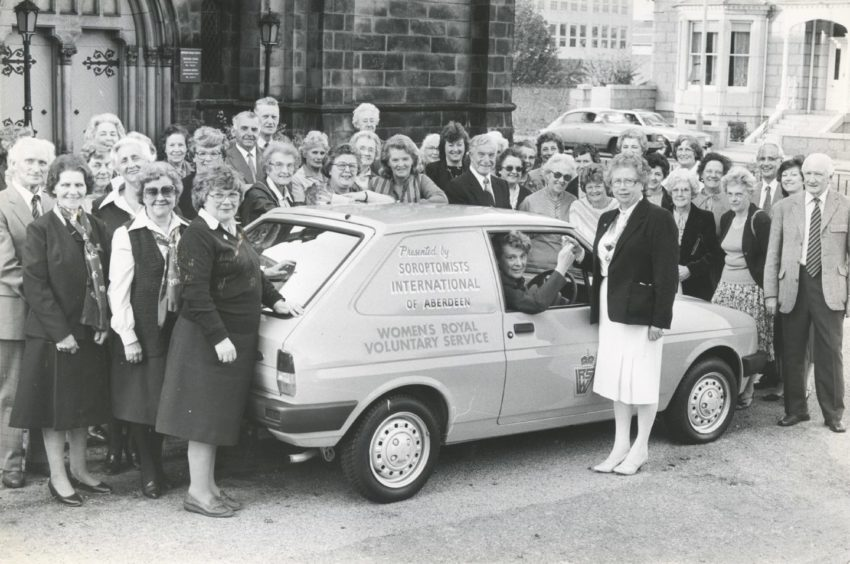 1984: Women's Royal Voluntary Service regional organiser Mrs Muriel Scanian (seated in car) is presented with the keys to the vehicle by Miss Norma Michie, president of Soroptimists International of Aberdeen at the WRVS Office last night. The van will be used for the Meals on Wheels service. The cost of the car was met from the proceeds of fund-raising activities by the 26 members of Aberdeen Soroptimists.