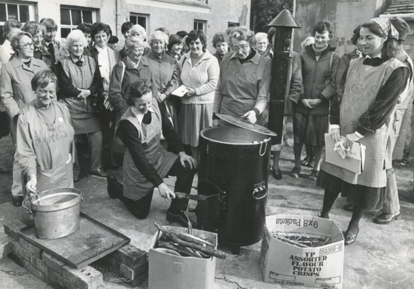 1984: Banchory WRVS members (left to right) Elaine Galloway, Pru Wilson, Jean Shinnie, and Diana Milligan show visitors different forms of emergency cooking.