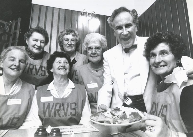 1989: Aberdeen District Council leisure and recreation department hosted the first of the annual treats for the handicapped and senior citizens in Westburn Park Lounge yesterday, and compere Robbie Shepherd decides to play host to the WRVS members who help out at the functions. Front, from left: Miss Ethel Hall, Miss Helen Lawrie and Mrs Cath Beattie, district organiser. Back: Mrs Beryl Simpson, Mrs Jill Walker and Mrs Nan Guillianotti.