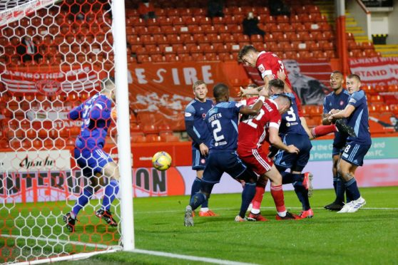 Tommie Hoban heads home Aberdeen's opener against Hamilton