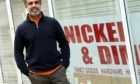 Naeem Ahmed outside the new shop