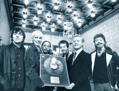 Aberdeen's home-grown superstar Annie Lennox and her then band, The Tourists, receive a silver disc from Lord Provost William Fraser at the Town House in 1980. It was for sales of the band's album, Reality Effect. Left to right are Peter Coombes, Annie, Eddie Chin, Jim Tooley, Lord Provost Fraser and Dave Stewart.