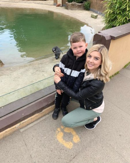 Samantha and her son Jacob enjoying a day out two months after her surgery