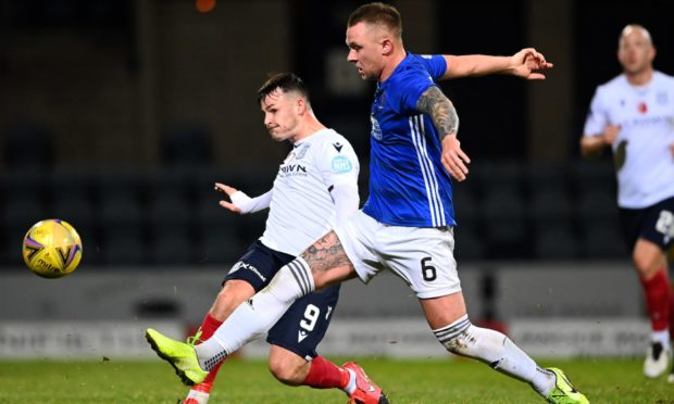 Ryan Strachan in action against Dundee striker Danny Mullen.