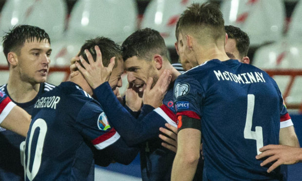 Ryan Christie celebrates his opening goal for Scotland against Serbia last night.
