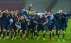 Scotland's players celebrate qualifying for Euro 2020