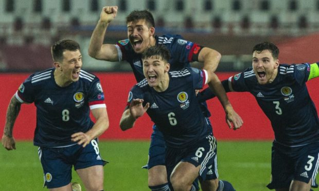Ryan Jack celebrates the penalty shoot-out win in Serbia to secure Euro 2020 qualification