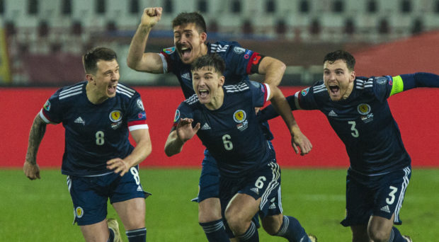 Andy Robertson, right, sprints to congratulate David Marshall after he saved the penalty to send Scotland to the Euros.