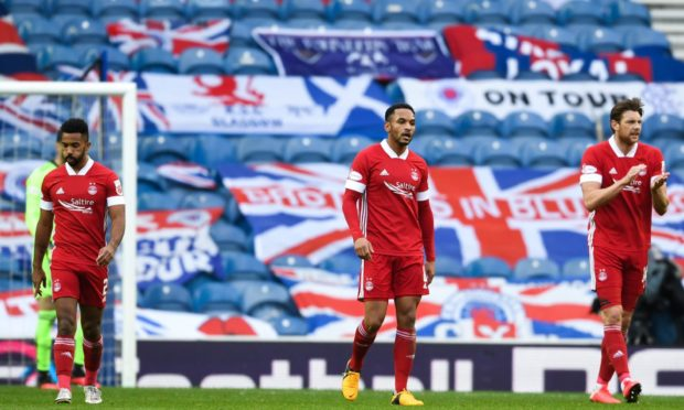 Aberdeen's Shay Logan, Funso Ojo and Ash Taylor after going 1-0 down to Rangers at Ibrox earlier this season.