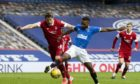 Aberdeen's Ash Taylor in action in the 4-0 loss at Rangers.