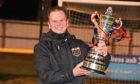 Rothes manager Ross Jack with the Highland League Cup trophy Picture by Kenny Elrick
