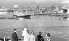 1968: In beautiful spring sunshine the three-masted schooner Malcolm Miller slips out of Aberdeen Harbour.