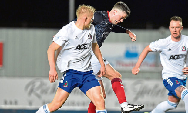 Anton Dowds (Falkirk) goes past Harry Milne (Cove Rangers) during the Scottish League 1 match.
