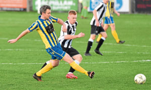 Lewis Duncan, of Fraserburgh, and Ryan Broadhurst, of Inverurie Locos, in their Evening Express Aberdeenshire Cup tie.   Picture by Paul Glendell    21/11 /2020