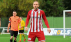 Jonny Smith in action for Formartine.  Picture by Darrell Benns