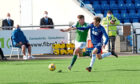 Blair Yule, right, in Betfred Cup action against Hibs striker Kevin Nisbet. Picture by Paul Glendell