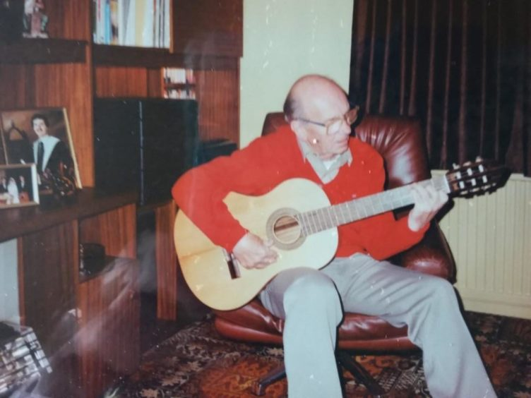 Bill playing his guitar.
