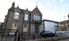 Windows were boarded up at Peterhead Sheriff Court following the incident.